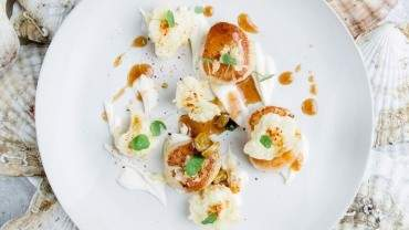 Image for Araxi's seared wild scallops with cauliflower tempura