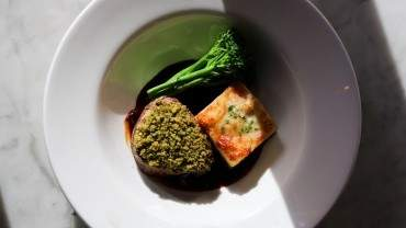Image for Cibo Trattoria's herb-crusted beef tenderloin with Parmesan potato pave