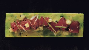 Image for The Dirty Apron Cookbook's ginger-soy tuna poke on pressed avocado