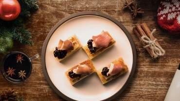 Image for Bridgette Bar's caramelized mozzarella crostini with cherry black pepper jam and prosciutto
