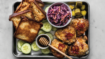 Image for Hot maple crackling chicken thighs with fried bread and coleslaw from the Eat With Us cookbook