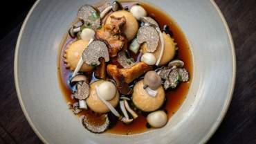Image for Wildebeest's ravioli mushroom with consommé, garlic  purée and pickled  mushrooms