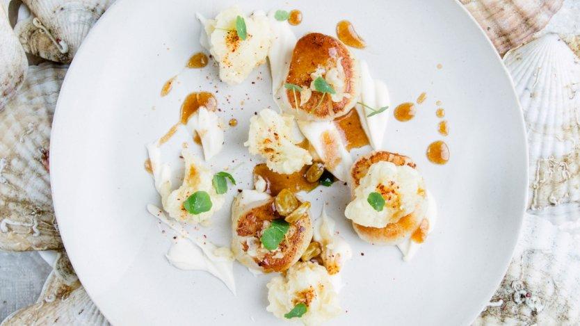 Image for Araxi's seared wild scallops with cauliflower tempura