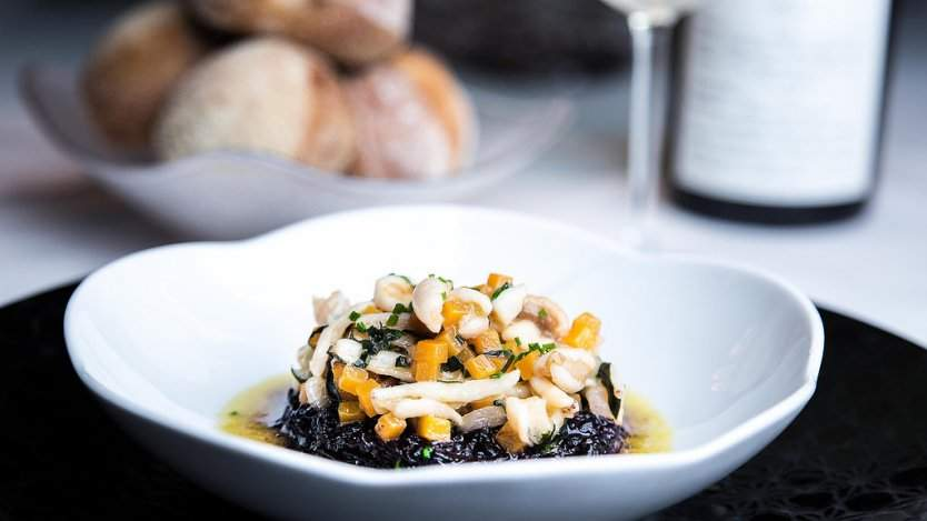 Image for Daily bite: Blue Water Cafe showcases uncommon Ocean Wise proteins in 14th annual  Unsung Heroes Festival. Black Himalayan risotto with giant red sea cucumber, pig's trotter, butternut squash and basil from 2017's Unsung Heroes Festival. Photo courtesy of Leila Likes.