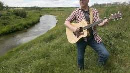 Image for One day in Olds, AB: singer-songwriter Dustin Farr