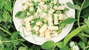 Image for Araxi's ricotta gnudi with peas and mint