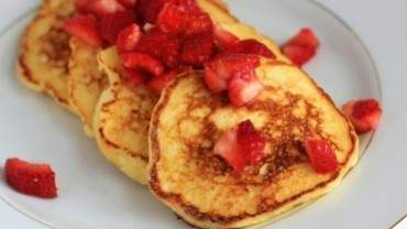Image for Lemon soufflé pancakes with macerated strawberries from Pucker cookbook