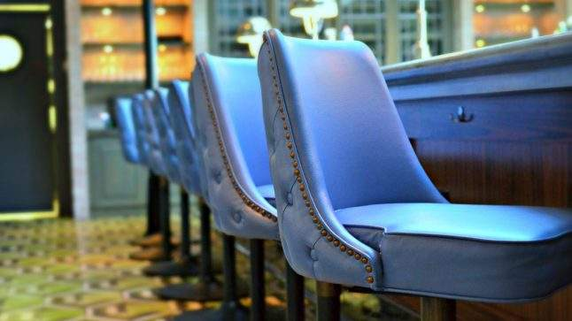 Candela's signature blue leather chairs