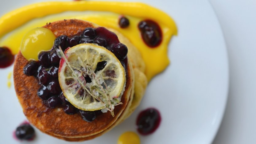 Image for Yellow Door Bistro's blueberry pancakes with blueberry thyme compote